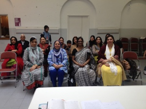 Gulshan Iqbal (centre) and Wandswoth Libraries staff celebrate Cityread London 2014 in Urdu